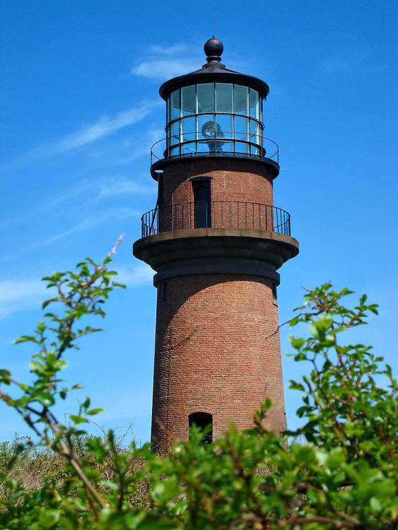 Gay Head Lighthouse at Aquinnah on Martha&rsquo;s Vineyard in Massachusetts<br /> The original lighthouse at the west end of Martha&rsquo;s Vineyard was built in 1799.  It was replaced in 1856 by this 51 foot, brick tower called the Gay Head Lighthouse.  But decades of erosion have eaten away at the Grey Head Cliffs where it stands so the Aquinnah Lighthouse is in danger of collapsing.  The plans are to relocate it in the spring of 2015.