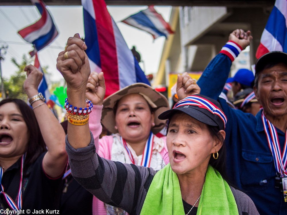 21 JANUARY 2014 - BANGKOK, THAILAND: Anti-government protestors march down Thanon Naradhiwas Rajanagarindra during a march by Suthep Thaugsuban. Suthep, the leader of the anti-government protests and the People's Democratic Reform Committee (PDRC), the umbrella organization of the protests, led a march through the financial district of Bangkok Tuesday. Shutdown Bangkok has entered its second week with no resolution in sight. Suthep is still demanding the caretaker government of Prime Minister Yingluck Shinawatra resign and the PM says she won't resign and intends to go ahead with the election.     PHOTO BY JACK KURTZ