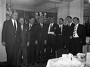 23/01/1962<br /> 01/23/1962<br /> 23 January 1962<br /> Long Service Award (25 years) of a watch presented to Mr. Hallwell, Dublin Maintenance Manager, Esso at the Gresham Hotel, Dublin. Mr Hallwell with his watch Proudly displayed 4th from right. Mr Denis Dunne (left), Director at Esso Petroleum Company (Ireland) Ltd. is 4th from left.