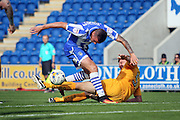 Cambridge Utd defender Mark Roberts tackles Colchester Utd forward Ben Dickenson on the edge of the box during the EFL Sky Bet League 2 match between Colchester United and Cambridge United at the Weston Homes Community Stadium, Colchester, England on 13 August 2016. Photo by Nigel Cole.