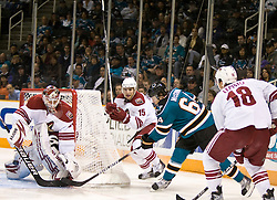 April 10, 2010; San Jose, CA, USA; Phoenix Coyotes goalie Ilya Bryzgalov (30) blocks a shot from San Jose Sharks left wing Jamie McGinn (64) during the second period at HP Pavilion. San Jose defeated Phoenix 3-2 in a shootout. Mandatory Credit: Jason O. Watson / US PRESSWIRE