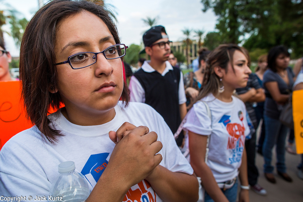 15 AUGUST 2012 - PHOENIX, AZ:  DREAM Act students in front of the Arizona State Capitol. About 200 people, mostly DREAM Act  (an acronym for Development, Relief, and Education for Alien Minors) students and their family members, marched on the Arizona State Capitol in Phoenix Wednesday after Arizona Governor Jan Brewer said the state of Arizona will not give DREAM Act students any state services, including driver's licenses or tuition breaks on state universities and schools. Brewer has been a critic of President Obama's plan to defer deportations of certain undocumented young people.  PHOTO BY JACK KURTZ