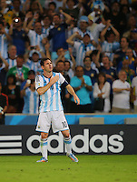 Lionel Messi of Argentina celebrates after scoring a goal to make it 2-0 in front of an Adidas sign