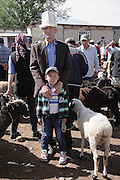People trading sheep at the weekly animal market in Kochkor (Kochkorka), Kyrgyzstan.