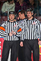 KELOWNA, CANADA - MARCH 4: Referee Chris Crich and linesman Travis Gawryletz stand on the ice as a goal is reviewed  on March 4, 2017 at Prospera Place in Kelowna, British Columbia, Canada.  (Photo by Marissa Baecker/Shoot the Breeze)  *** Local Caption ***