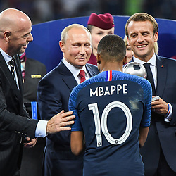 FIFA president Gianni Infantino, Russia's President Vladimir Putin, Kylian Mbappe of France and France's President Emmanuel Macron during the World Cup Final match between France and Croatia at Luzhniki Stadium on July 15, 2018 in Moscow, Russia. (Photo by Anthony Dibon/Icon Sport)