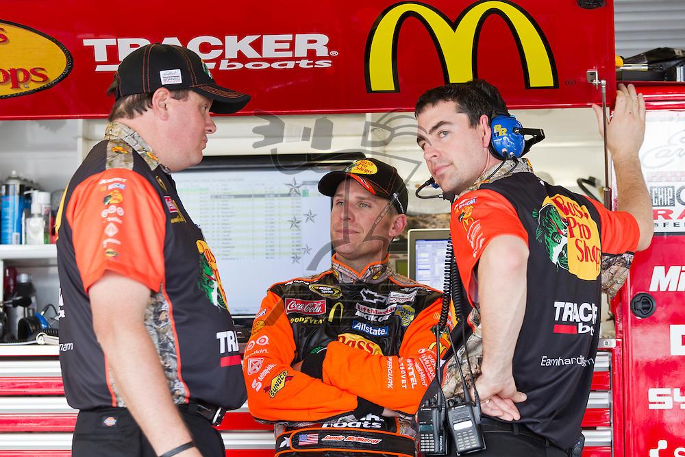 Daytona Beach, FL - Feb 18, 2012:  Jamie McMurray (1) talks to his crew before a practice session for the Daytona 500 at the Daytona International Speedway in Daytona Beach, FL.