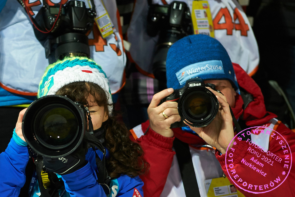 Photographers shoot pictures during FIS World Cup Ski Jumping competition in Wisla, Poland on January 15, 2015.<br /> <br /> Poland, Wisla, January 15, 2015.<br /> <br /> Picture also available in RAW (NEF) or TIFF format on special request.<br /> <br /> For editorial use only. Any commercial or promotional use requires permission.<br /> <br /> Mandatory credit:<br /> Photo by &copy; Adam Nurkiewicz / Mediasport
