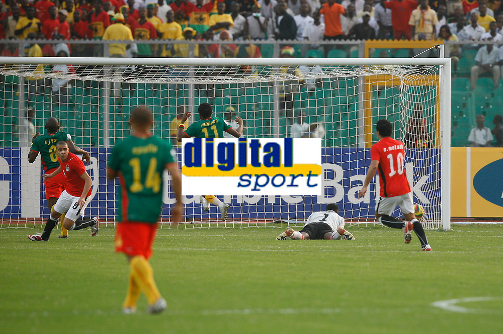 Photo: Steve Bond/Richard Lane Photography.<br />Egypt v Cameroun. Africa Cup of Nations. 22/01/2008. Mohamed Zidan (L) turns as his shot enters the Cameroun net for the second goal