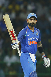 September 3, 2017 - Colombo, Sri Lanka - Indian cricket captain Virat Kohli raises his bat after scoring 50 runs during the 5th and final One Day International cricket match between Sri Lanka and India at the R Premadasa international cricket stadium at Colombo, Sri Lanka on Sunday 3 September 2017. (Credit Image: © Tharaka Basnayaka/NurPhoto via ZUMA Press)