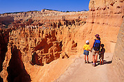 Mother and kids (ages 4 & 8) looking out at the Silent City from the Navajo Trail, Bryce Canyon National Park, Utah