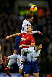 LONDON, ENGLAND - Sunday, January 13, 2019: Manchester United's Nemanja Matić challenges for a header with Tottenham Hotspur's Dele Alli (top) and Son Heung-min (bottom) during the FA Premier League match between Tottenham Hotspur FC and Manchester United FC at Wembley Stadium. (Pic by David Rawcliffe/Propaganda)