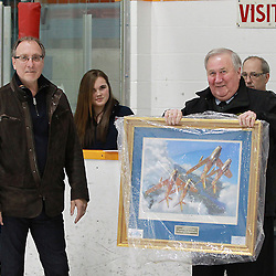 TRENTON, ON - Mar 27, 2015 : Ontario Junior Hockey League game action between the Trenton Golden Hawks and the Kingston Voyageurs. Game one of the North East Championship Series. Trenton Golden Hawks Team Governor presents Trenton's Director of Operations John McDonald with a special award on behalf of the Hawks Organization in recognition of him being named the OJHL's  Volunteer of the Year.<br /> (Photo by Tim Bates / OJHL Images)