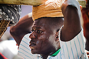 One of four porters carrying a palanquin occupied by a traditional chief during the parade held on the occasion of the annual Oguaa Fetu Afahye Festival in Cape Coast, Ghana on Saturday September 6, 2008..