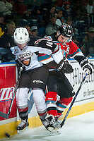 KELOWNA, CANADA - NOVEMBER 11:Tyson Baillie #24 of Kelowna Rockets checks James Malm #14 of Vancouver Giants at the boards behind the net  on November 11, 2015 at Prospera Place in Kelowna, British Columbia, Canada.  (Photo by Marissa Baecker/ShoottheBreeze)  *** Local Caption *** Tyson Baillie; James Malm;