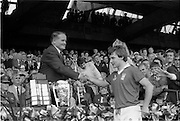 07/09/1986<br /> 09/07/1986<br /> 7 September 1986<br /> All-Ireland Senior and Minor Hurling Finals at Croke Park, Dublin.<br /> Presentation of the Senior Hurling Final 1986 Cup<br /> Dr. Michael Loftus (left), President of the G.A.A., presents the Liam McCarthy Trophy to Tom Cashman, captain of the Cork team.