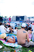 People relaxing on the grass, Vans Warped Tour, USA touring punk rock music festival, Bicentennial park, Miami, Florida, USA. 24th June 2006