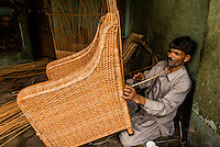 Man making ratan chairs, Srinagar, Kashmir, Jammu and Kashmir State; India.