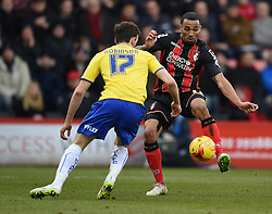 Bournemouth's Callum Wilson is challenged by Huddersfield Town's Jack Robinson - Photo mandatory by-line: Paul Knight/JMP - Mobile: 07966 386802 - 14/02/2015 - SPORT - Football - Bournemouth - Goldsands Stadium - AFC Bournemouth v Huddersfield Town - Sky Bet Championship