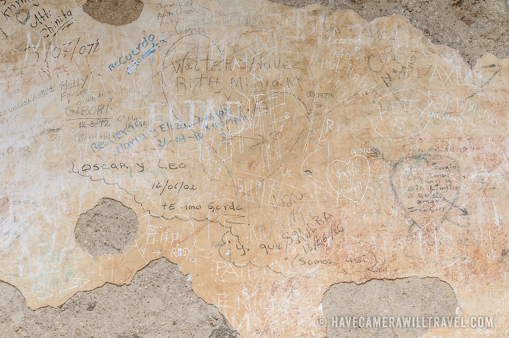 Graffiti on plaster at Iglesia y Convento de La Recolección in Antigua, Guatemala.
