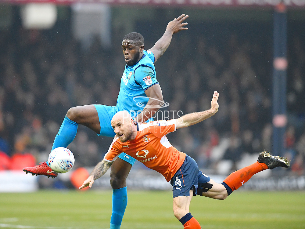 Luton Towns player Alan McCormack is fouled high by Barnets John Akinde during the EFL Sky Bet League 2 match between Luton Town and Barnet at Kenilworth Road, Luton, England on 24 March 2018. Picture by Ian  Muir.during the EFL Sky Bet League 2 match between Luton Town and Barnet at Kenilworth Road, Luton, England on 24 March 2018. Picture by Ian  Muir.