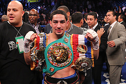 Oct 19, 2012; Brooklyn, NY, USA; WBC/WBA super lightweight champion Danny Garcia celebrates his 4th round KO win over Erik Morales at the Barclays Center.