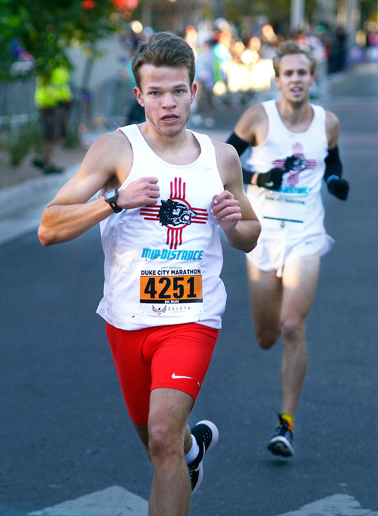 gbs101616s/SPORTS -- Adam Monroe of Albuquerque sprints to the finish to win the men's 5K run during the Duke City Marathon on Sunday, October 16, 2016. (Greg Sorber/Albuquerque Journal)