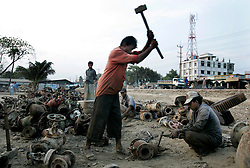 BANGLADESH MADHOM BIBIR HAT 6MARB05 - Labouroers break valves at one of the many secondary businesses selling hardware recovered from shipbreaking yards at Badhom Bibir Hat outside Chittagong, Bangladesh. <br /> <br /> jre/Photo by Jiri Rezac<br /> <br /> © Jiri Rezac 2005