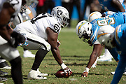 Oakland Raiders center Rodney Hudson (61) and the Raiders offensive line get set to snap the ball at the line of scrimmage opposite the Los Angeles Chargers defensive lineduring the NFL week 5 regular season football game against the against the Los Angeles Chargers on Sunday, Oct. 7, 2018 in Carson, Calif. The Chargers won the game 26-10. (©Paul Anthony Spinelli)