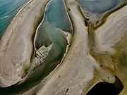 Tweede Maasvlakte (MV2), de Slikken van Voorne, op de grens met Maasvlakte (Slufterstrand). De slikken maken deel uit van de Voordelta, Natura 2000-gebied en onderdeel van de Ecologische Hoofdstructuur. Het belangrijk zeereservaat is ontstaan na het afdammen van de Maas en het opspuiten van de Maasvlakte.<br /> Second Maasvlakte (MV2), the Slikken van Voorne, on the border with Maasvlaktestrand (Slufterstrand). The mud flats are part of the Voordelta, Natura 2000 area and part of the National Ecological Network. The important marine reserve was created after the damming of the Maas and the creation of the Maasvlakte.<br /> <br /> luchtfoto (toeslag op standard tarieven);<br /> aerial photo (additional fee required);<br /> copyright foto/photo Siebe Swart