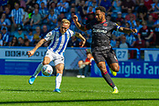 Huddersfield Town Alex Pritchard and Reading Liam Moore during the EFL Sky Bet Championship match between Huddersfield Town and Reading at the John Smiths Stadium, Huddersfield, England on 24 August 2019.