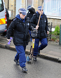© London News Pictures. 05/01/2016. A Police search team take digging equipment in to the home of former Eastenders actress Sian Blake in Erith, Kent, which has been turned into a crime scene today (05/01/2016). Sian Blake and her two children have been missing for more than three weeks. Her partner has been described as a 'high-risk missing person'. Photo credit: Grant Falvey/LNP