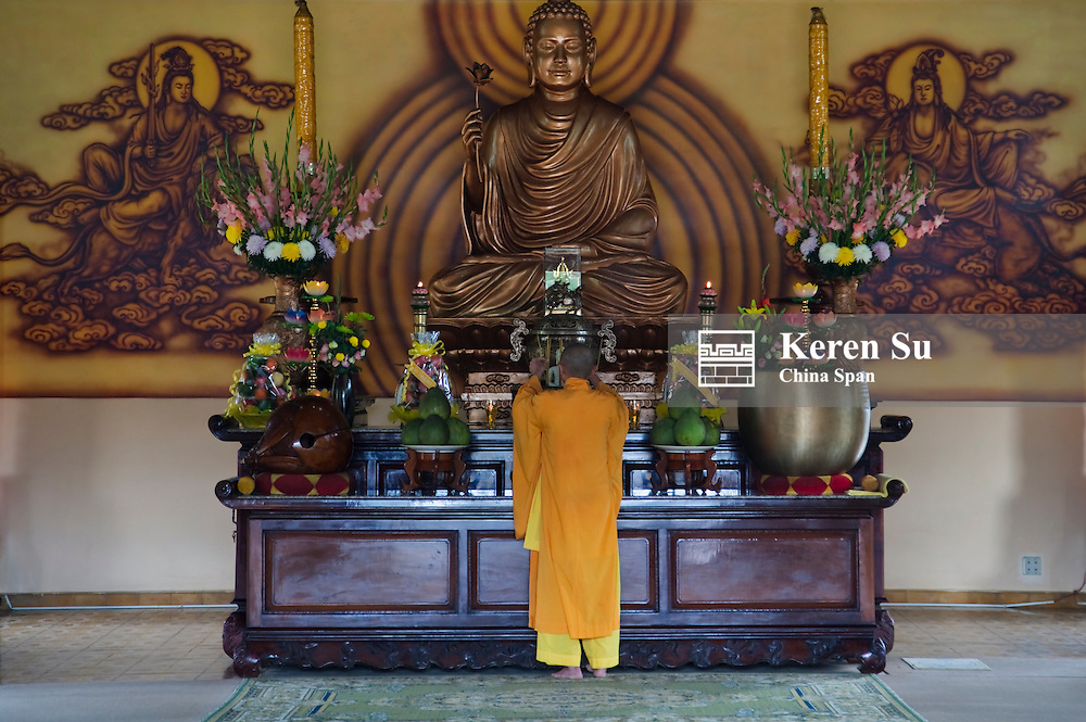 Monk in Buddhist temple.