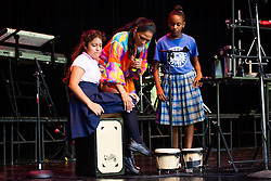 Sheila E. plays the cajon and lets Marianellie Colon, left, and Yafreisi Segura try for themselves.  Sheila E. conducts the latest Arts in Education residency for K-12 students at the Reichhold center.  Students shared their talent for drums, singing, and dancing and learned about the types of instruments and sounds that Sheila E. is known for.  Sheila E. will be performing at the Reichhold center on Saturday, October 5th at 8pm.  4 October 2013.  Reichhold Center.  St. Thomas, USVI.  © Aisha-Zakiya Boyd