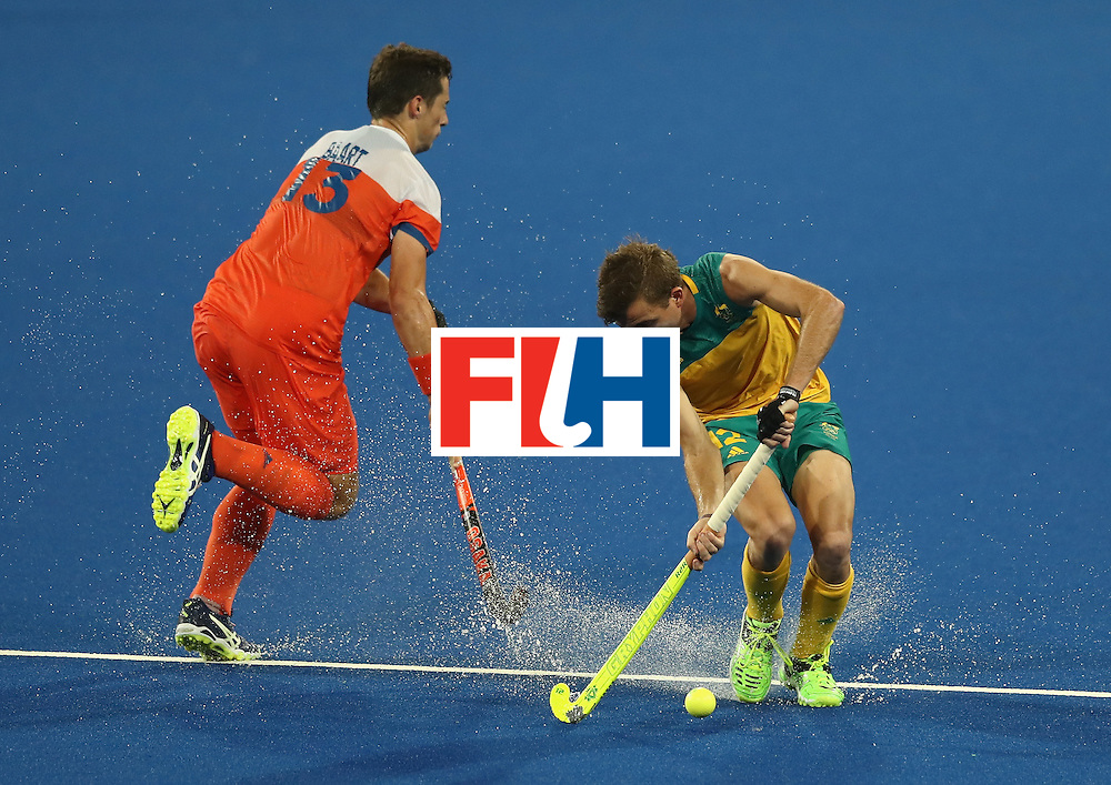 RIO DE JANEIRO, BRAZIL - AUGUST 14:  Jacob Whetton of Australia beats Sander Baart to the ball during the Men's hockey quarter final match between the Netherlands and Australia on Day 9 of the Rio 2016 Olympic Games at the Olympic Hockey Centre on August 14, 2016 in Rio de Janeiro, Brazil.  (Photo by David Rogers/Getty Images)