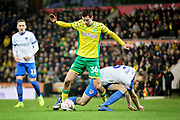 Norwich City midfielder Todd Cantwell (36) and Portsmouth defender Matthew Clarke (5) get tangled up during the The FA Cup 3rd round match between Norwich City and Portsmouth at Carrow Road, Norwich, England on 5 January 2019.