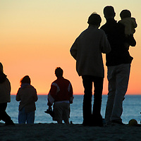 Beach-goers admire this years final sunset at Santa Monica Beach on Monday, December 31, 2007.