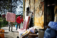 Rosarno, Italia - 19 dicembre 2010. Immigrati organizzano i beni di prima necessità forniti dai volontari dell'associazione Calafrica. L'associazione Calafrica si prende cura della comunità degli immigrati di Rosarno fornendo loro beni di prima necissità quali materassi, coperte e indumenti..Ph. Roberto Salomone Ag. Controluce.ITALY - Immigrants reorder goods brought by volunterrs of Calafrica association in Rosarno on December 19, 2010. Calafrica association takes care of the immigrants community in Rosarno.