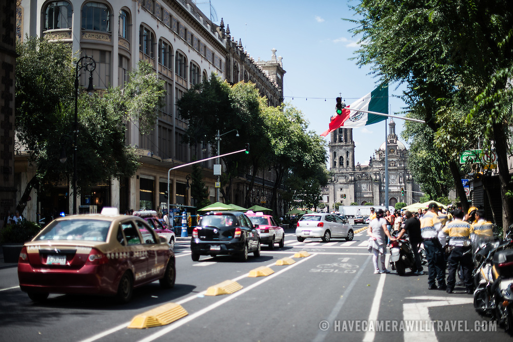 A view toward the Metropolitan Cathedral down a street in the Centro Historico in Mexico City, Mexico.