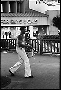 A man laughing as he clutches his ghetto blaster, downtown SanFrancisco, USA, 1980.