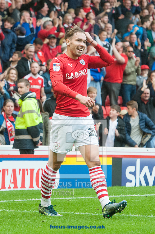 Tom Bradshaw of Barnsley celebrates after scoring his sides third goal during the Sky Bet Championship match at Oakwell, Barnsley<br /> Picture by Matt Wilkinson/Focus Images Ltd 07814 960751<br /> 27/08/2016