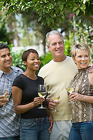 Two couples drinking wine outdoors