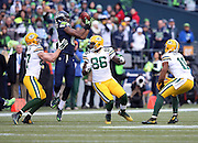 Green Bay Packers tight end Brandon Bostick (86) and Green Bay Packers wide receiver Jordy Nelson (87) look on as Seattle Seahawks wide receiver Chris Matthews (13) leaps and catches an onside kick that gives the Seattle Seahawks the ball at the 50 yard line with just over two minutes left on the fourth quarter clock during the NFL week 20 NFC Championship football game against the Green Bay Packers on Sunday, Jan. 18, 2015 in Seattle. The Seahawks won the game 28-22 in overtime. ©Paul Anthony Spinelli