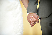 A bride and groom hold hands after their church wedding in Coloma, CA. Their reception was at the Coloma Country Inn on  Oct. 29, 2011.