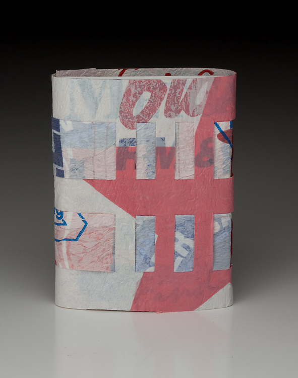 Book cover using plastic cloth and snaps.