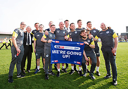 Free to use courtesy of Sky Bet - Wigan Athletic manager Paul Cook and his staff celebrate winning promotion to the Sky Bet Championship - Mandatory by-line: Robbie Stephenson/JMP - 21/04/2018 - FOOTBALL - Highbury Stadium - Fleetwood, England - Fleetwood Town v Wigan Athletic - Sky Bet League One