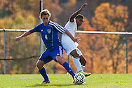 CVU's Trey Tomasi (25) battles for the ball with Mt. Anthony's Nadrew Griffin-Leon (4) during the boys semifinal soccer game between Mount Anthony and Champlain Valley Union at CVU high school on Tuesday afternoon October 27, 2015 in Hinesburg. (BRIAN JENKINS/ for the FREE PRESS)