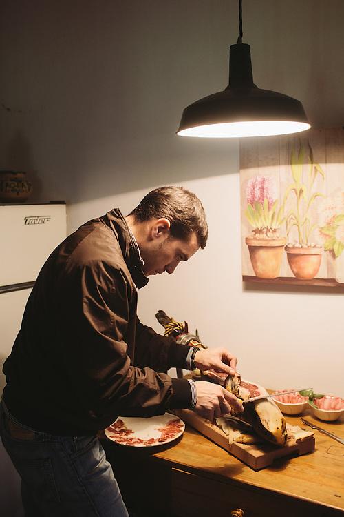 Sergio Venegas cuts slices of Jamon Iberico, Extramedura, Spain.