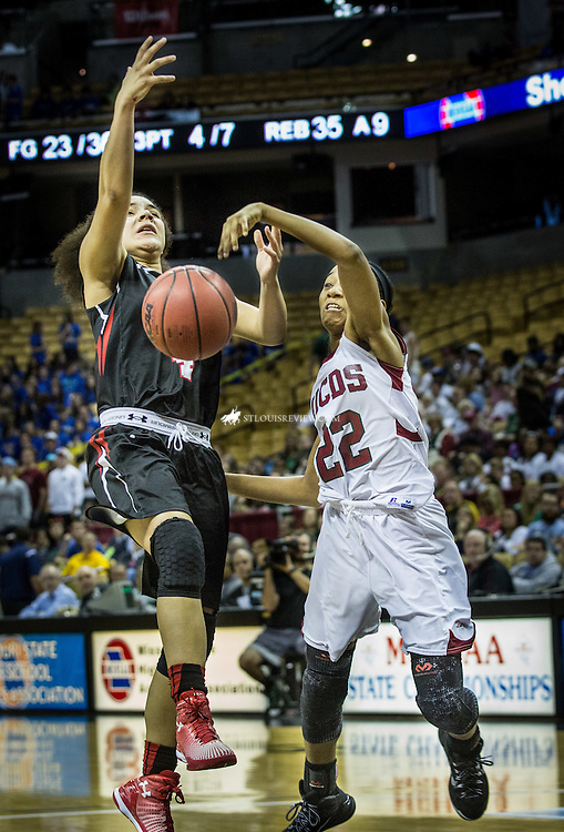 Lisa Johnston | lisajohnston@archstl.org  | Twitter: @aeternusphoto  Incarnate Word Acadamy guard, Ivana Easley, had the ball stripped away by MICDS's KK Rodriguez  in the second half of the Class 4 Girls Basketball State Championship game between Incarnate Word Academy Red Knights and MICDS Rams.  Incarnate Word Academy won their third Red Knight championship with a score of 60 - 27.