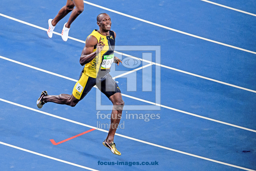 Usain Bolt of Jamaica retains his title and wins his third successive Gold Medal in the Men's 100m on day nine of the XXXI 2016 Olympic Summer Games in Rio de Janeiro, Brazil.<br /> Picture by EXPA Pictures/Focus Images Ltd 07814482222<br /> 14/08/2016<br /> *** UK &amp; IRELAND ONLY ***<br /> <br /> EXPA-EIB-160815-0061.jpg
